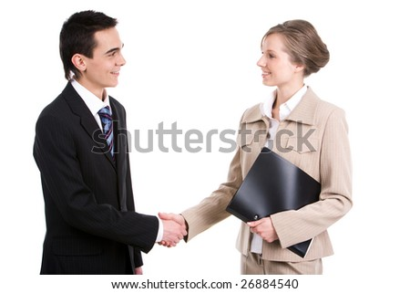 Portrait of successful business partners shaking hands after striking a deal