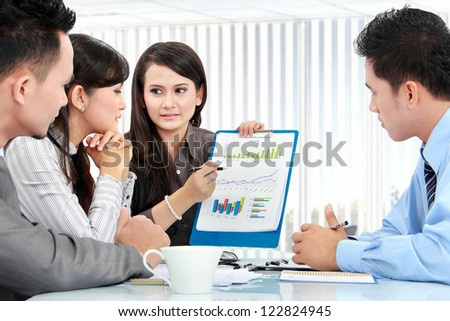 Portrait of successful business people having a discussion in the office - stock photo