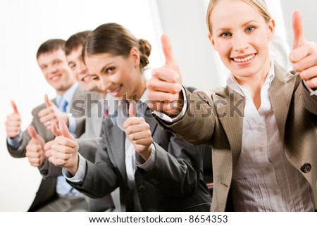 Portrait of successful business people showing a sing of okay - stock photo