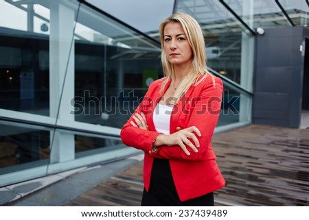 Portrait of successful business woman looking confident - stock photo