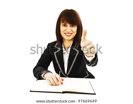 Portrait of successful business woman showing thumbs up sign.  Isolated on white background