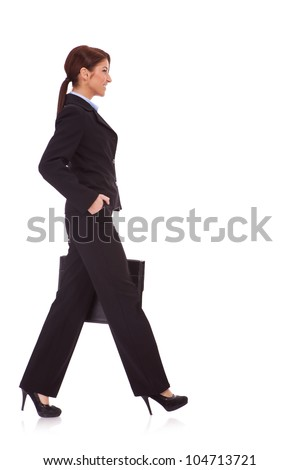 Portrait of successful business woman walking with a briefcase - White background - stock photo