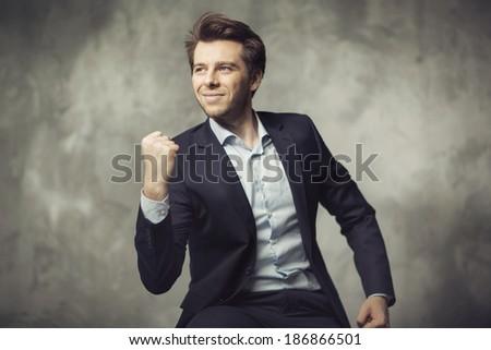 Portrait of successful businessman - stock photo