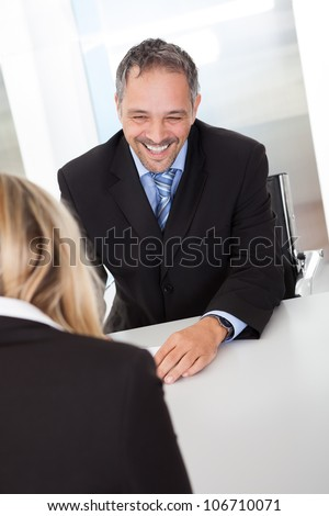 Portrait of successful businessman at the interview - stock photo
