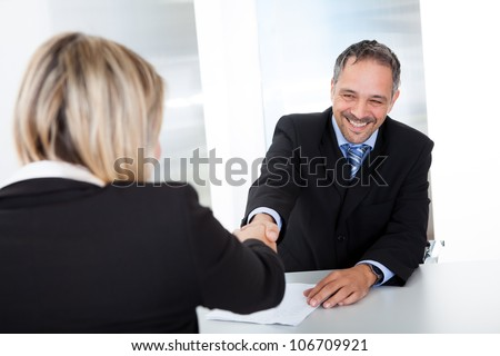 Portrait of successful businessman at the interview shaking hands