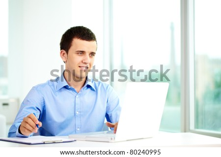 Portrait of successful businessman working on computer - stock photo