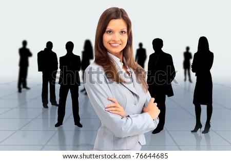 Portrait of successful businesswoman and business team