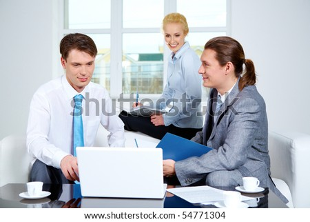 Portrait of successful co-workers sharing their ideas in office at meeting - stock photo