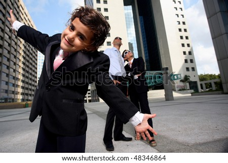 Portrait of successful family businesspeople near a office building having fun - stock photo