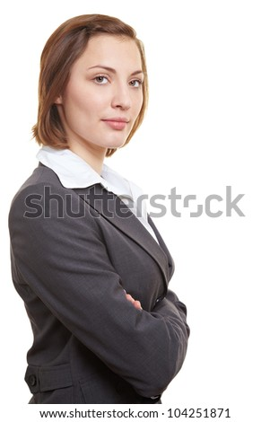 Portrait of successful female executive with her arms crossed - stock photo