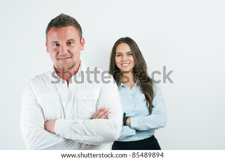 Portrait of successful happy smiling young businessman and colleague on background, at office