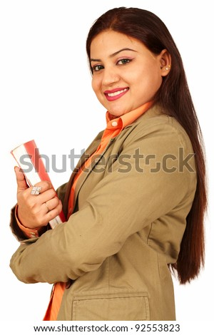 Portrait of successful Indian business woman with hands folded - stock photo
