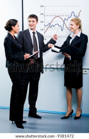 Portrait of successful man explaining a new project to colleagues - stock photo