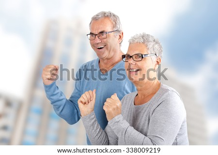 portrait of successful mature couple cheering, age and people concept - happy senior couple  - stock photo