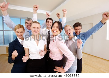 Portrait of successful people raising hands showing gladness - stock photo