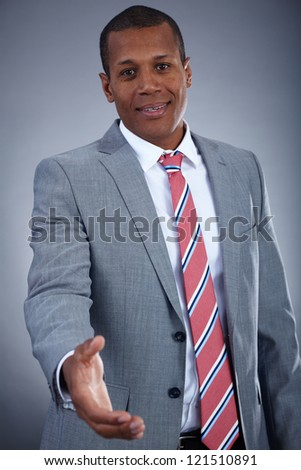 Portrait of successful professional in suit ready for handshake - stock photo