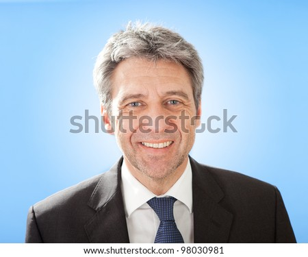 Portrait of successful senior businessman on sky - stock photo