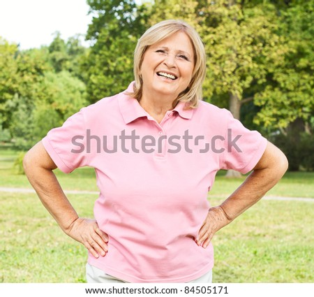 Portrait of successful senior woman outdoors. - stock photo