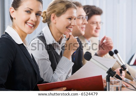 Portrait of successful smiling young woman at a seminar