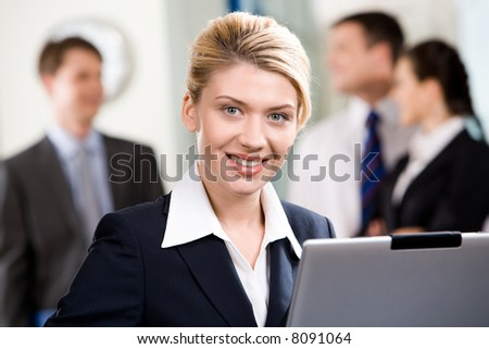 Portrait of successful specialist with wonderful smile in a office environment