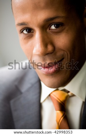 Portrait of successful white collar worker looking at camera and smiling - stock photo
