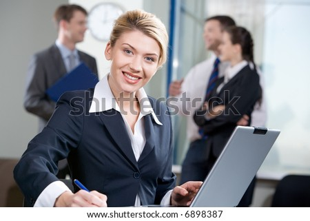 Portrait of successful woman with wonderful smile on the background of business people