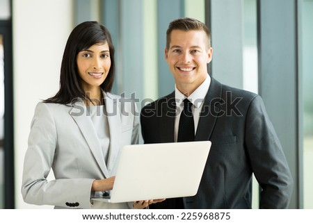 portrait of successful young business executive in modern office - stock photo