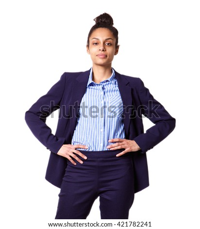 Portrait of successful young business woman standing with her hands in hips against white background  - stock photo