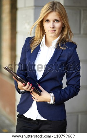 Portrait of Successful young business woman with modern tablet PC - stock photo