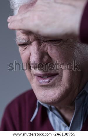 Portrait of suffering man having sinus pain - stock photo