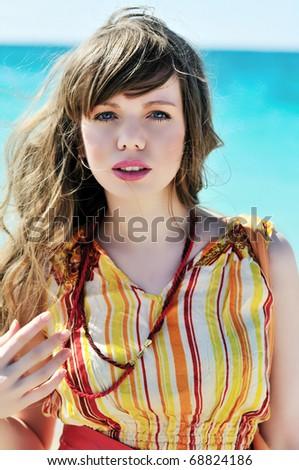 portrait of summer beautiful girl near the sea - stock photo