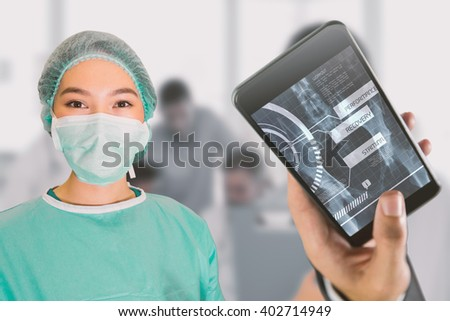 Portrait of surgeon woman against cheerful young surgeon posing with colleagues in background - stock photo