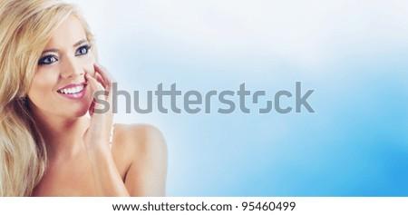 Portrait of surprised blond women, studio shot - stock photo