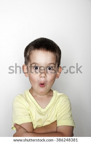 Portrait of surprised boy - stock photo