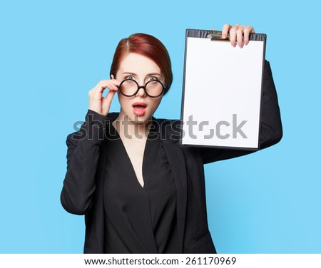 Portrait of surprised business women in glasses on blue background - stock photo