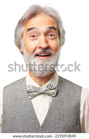 Portrait of surprised caucasian aged man with a gray beard and bowtie isolated on white background - stock photo