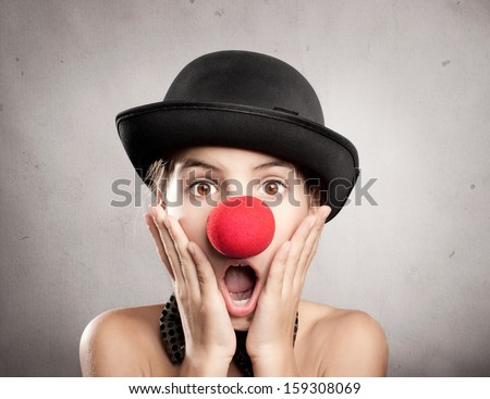 portrait of surprised little girl with a clown nose - stock photo