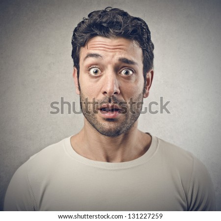 portrait of surprised man - stock photo
