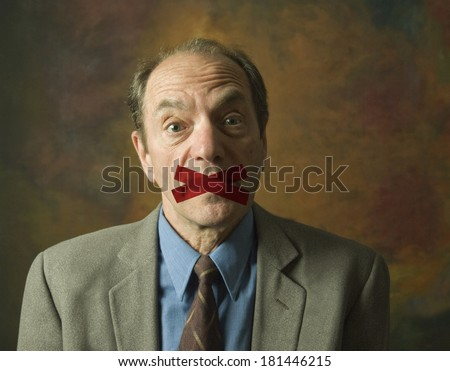 portrait of surprised man with mouth taped shut - stock photo