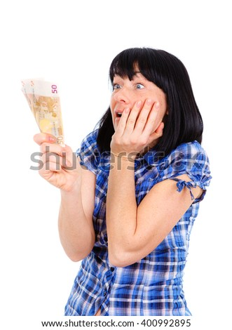 Portrait of Surprised mature woman holding money euro banknotes in hand isolated white background. Emotion facial expression feeling. Financial reward savings