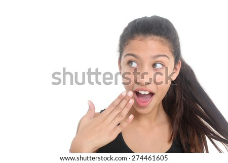 portrait of surprised  teen girl on a white background - stock photo