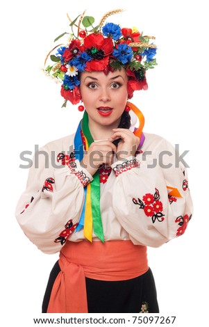 Portrait of surprised woman in the Ukrainian national clothes - stock photo