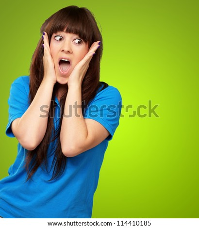 portrait of surprised woman isolated on green background - stock photo