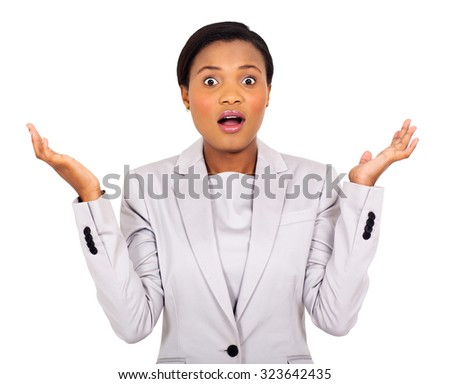 portrait of surprised young african businesswoman on white background - stock photo