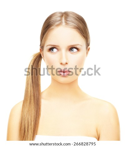 Portrait of surprised young girl whistling at the camera. Studio shot on a white  background - stock photo