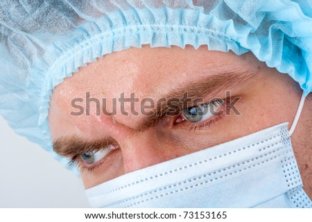 Portrait of sweat serious surgeon in surgical mask