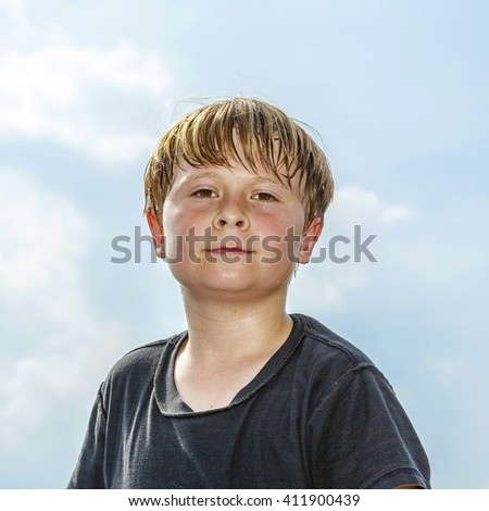 portrait of sweating boy after sport looks confident