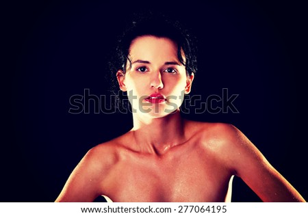 Portrait of sweaty nude woman. - stock photo
