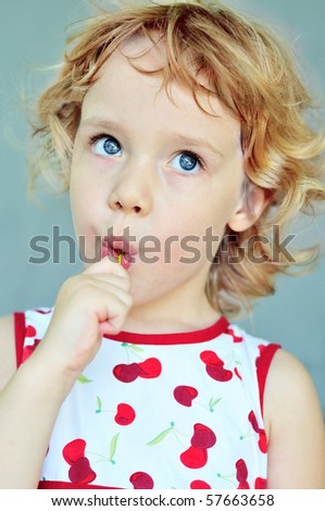 portrait of sweet girl with lollipop - stock photo