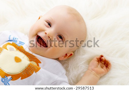 Portrait of sweet little baby boy on white background - stock photo